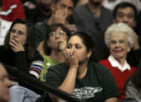 (DENVER shot on 3/10/05)   Colorado State University basketball fan Lynette Duran (center), 22, of...