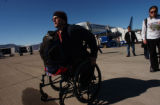 Eagle, Colo.shot on 2/24/05-- Chris Fesmire, 26 from Cali. wheels himself to the terminal.  He has...