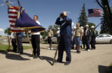 (BRUSH, Colo., May 30-31, 2004) Stan gray adjusts his cap before ceremonies begin at the Brush...