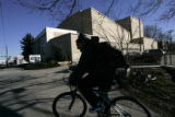 (2/28/05, Denver, CO) Anna Owns-Thesabre (CQ) rides her bike past the Lowenstein Theater.  The...
