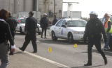 Denver, Colo.-March 1-2005)- Denver Police investigate the scene of a pedestrian death on west...