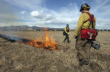 (GUNBARREL, Colo., March 1, 2005) Brian James, firefighter, foreground right of frame with drip...