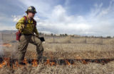 (GUNBARREL, Colo., March 1, 2005) Brian Oliver, firefighter and crew boss heads up the line to...