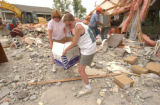 (Granby, CO, Shot on 060804) Johnson Media photojournalist Jean Landess (right) helps accountant...