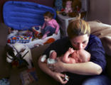 (FOUNTAIN, Colo., February 27, 2005) Shawn Viera (cq) kisses her newborn baby Cayden Viera (cq)...
