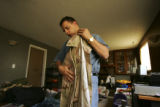 (Fountain, Colo., March 1, 2005) Sgt. Christopher Viera (cq) folds his uniform while packing his...
