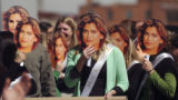 (DENVER, Colo., March 17, 2005)   Natalie Anderson, light green sweater, joins her fellow workers...