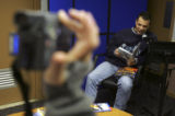 (FORT CARSON, Colo., March 1, 2005) Sgt. Christopher Viera (cq), right, reads a book while being...