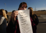 Aurora, Colo. shot on 3/3/05-- Rosemary Singer who works in police record holds a sign expressing...