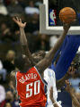 (DENVER, Colo., March 16, 2005)  Francisco Elson goes up for a block against Emeka Okafor in the...