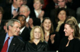 (DENVER shot on 3/21/05)   President George W. Bush shares a laugh with Joleen Mossoni (cq,...