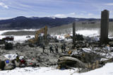 (ELECTRIC MOUNTAIN, Colo., March 22, 2005) Emergency workers sift through the ashes for the...