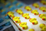 (DENVER, Co. - Shot 3/2/2005) Sheets of little yellow ducks that decorate the marzipan eggs at...