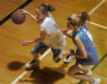 (DENVER, COLORADO:  FEBRUARY 15, 2005)  Julia Porter, 12, (cq Julia Porter) left, dribbles past...