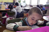 (DENVER, Colo., March 9, 2005)  @nd grader Eddie Chiafalo works on his homework during class at...