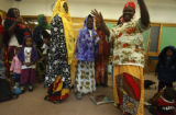 Denver, Colo. shot on 3/9/05)  Bantu Somali refugee women dance and sing with their children...
