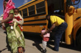 (Denver, Colo.shot on 3/2/05) Arriving at school, Faduma Mahina (cq) carries  Nastexo Rasulo, 10...
