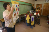 (Denver, Colo.shot on 3/2/05) Teacher, Norma Trujillo goes over colors with her class of Somali...