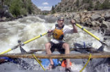 (BUENA VISTA, Colorado... June 9, 2004) River Runner rafting company  guide Spencer Storm rows...