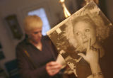 (Denver shot on 3/10/05)  Kathleen Donohue(cq),38, of Denver hold up recent photos she took of her...