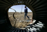 (HUGO, Colo., March 10, 2005) - Greg King , a FSA (Farm Services Agency) agent walks past a...