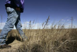 (HUGO, Colo., March 10, 2005) - Greg King , a FSA (Farm Services Agency) agent walks in an...