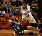 (BOULDER, Colo., March 10, 2005) Antoine Watson, right, of the Harrison Panthers, tries to steal...