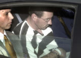 Denver, Colo.-February 19,2005- Brent J. Brents (striped shirt) ,  the serial rapist accused in...