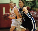 (AURORA, Colo., February 18, 2005, 2004)  Regis Jesuit's Katie Mihalco drives around Highlands...