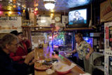 (WOODY CREEK, Colo., 2/20/05)Woody Creek locals and a bartender talk Sunday night, February 20,...