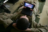 "03/25/2005 Denver-Pfc. Levi Dowty, 23, Warm Springs Oregon, watches ""Manchurian..."