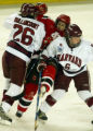 NHTB101 - St. Lawrence's Emilie Berlinguette, center, is squeezed by Harvard's Sarah Vaillancourt,...