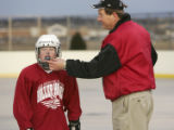 (PARKER, Colo., March 29, 2005) Sen. John Evans, R-Parker, right, at roller hockey practice with...