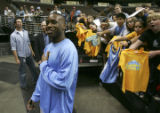 (DENVER, Colo., March 16, 2005)  A group of children yell for Earl Boykins to signs autographs at...