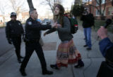(03/11/05, Colorado Springs, CO)  Matt Springer, 22, is pushed away from the protester's van by...