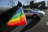 (03/11/05, Colorado Springs, CO)  Tradeal Robinson, 20, from Colorado Springs, holds up a gay...