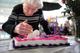 03/11/2005 Denver-Marion Stiles, 95, blows out candles on her cake during a birthday party for her...
