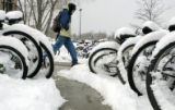 (DENVER, Colo., March 13, 2005)  Del Olivas, from Denver,  sweeps several inches of snow off of...