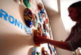 (DENVER, Colo., April 13, 2004) Darci Hill, of D. Hill Studios, hangs masks painted by Frontier...