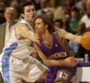 Denver, Colo., photo taken March 13, 2005- Nugget's forward, Edwardo Najera (cq left) tightly...