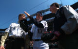 (Denver,CO - Shot on 4/12/04)  The Colorado Rockies' Todd Helton (#17) gives pointers to Mayor...