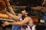 Kings Peja Stojakovic lays a ball in for two points past Kevin Garnett (right) and Rasho...