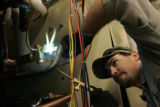 (2/23/05, Aspen, CO)  Jesse Pifer, from Energy Services of Colorado,replaces valves on a heat pump...