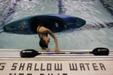 ( DENVER-3/15/2005 )  Novice kayaker Janet Hirsh (cq) practices rolling during a clinic at the El...