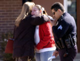 (COMMERCE CITY, Colo., March 15, 2005) Delia Guzman (cq) ( center ) is comforted by Commerce City...