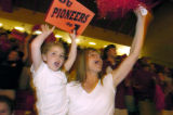(Denver, Colo., April 13, 2004) DU hockey fans Loughran Sutton, 4, left, and Robin Sutton, right,...