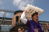 (Denver, Colo., April 12, 2004) Vendor Nick Watts, of Denver, laughs while selling hot chocolate...