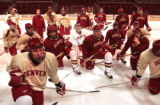 Denver, Colo., photo taken October 19, 2004-Denver University Pioneers Hockey team gather around...