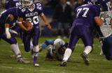 (ARVADA, Colo., October 7, 2004) Wildcats # 20 Scott Sanchez, breaks through a gaping hole...
