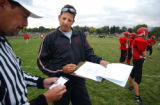 (DENVER, Co., SHOT 9/28/2004) Colorado School of the Deaf and Blind head coach Joe Manson, who is...